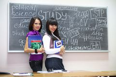 Two students near blackboard Royalty Free Stock Photography