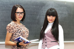 Two students near the blackboard Royalty Free Stock Image