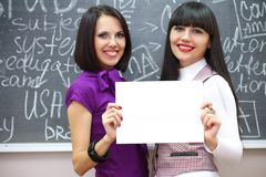Two students near the blackboard Royalty Free Stock Photos