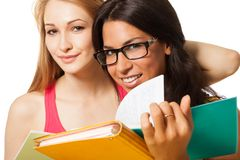 Two students with note pads Royalty Free Stock Photo