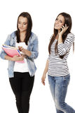 Two students one hanging on the phone Royalty Free Stock Images