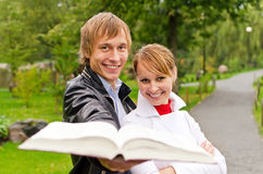 Two students with open book Stock Image