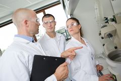 Two students performing experiment stock photography