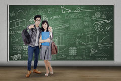 Two students pointing camera at class Royalty Free Stock Photo