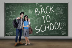 Two students pointing at camera Royalty Free Stock Images