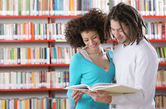 Two students reading a book Stock Photography