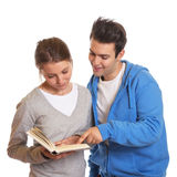 Two students reading a book. On an isolated white background Royalty Free Stock Photography
