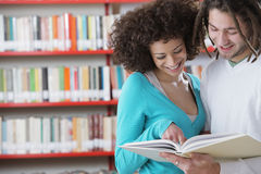 Two students reading a book Stock Image