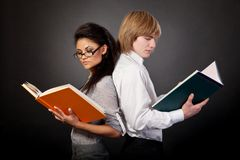 Two students are reading books Royalty Free Stock Image