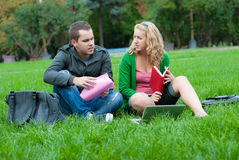 Two students relax and talking Royalty Free Stock Photos
