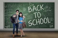 Two students showing thumbs up Stock Image
