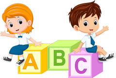 Two students sitting on the alphabet blocks Stock Photography