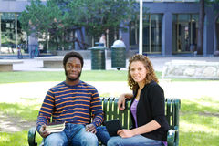 Two students sitting on bench Stock Photos
