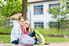 Two students sitting at school in recess Royalty Free Stock Photos