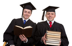 Two students sitting together, one reading and the other holding Royalty Free Stock Photography