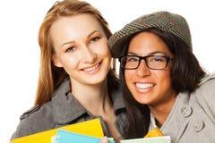 Two students smiling at camera Stock Photos