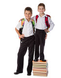 Two students standing with pile of books Royalty Free Stock Photos