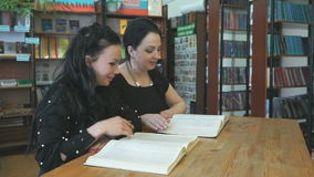 Two students studying books at library stock video