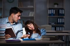 The two students studying late at night. Two students studying late at night Stock Images