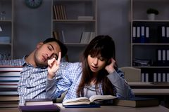 The two students studying late at night. Two students studying late at night Royalty Free Stock Photos