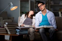 The two students studying late preparing for exams. Two students studying late preparing for exams Stock Photo