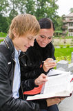 Two students studying outdoors Royalty Free Stock Images