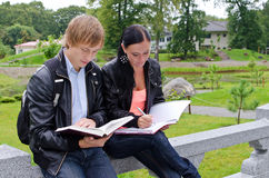Two students studying outdoors Royalty Free Stock Photo