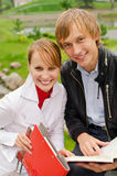Two students studying outdoors Stock Images