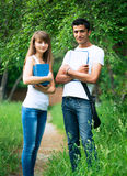 Two students studying in park Royalty Free Stock Photos