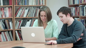 Two students studying together using laptop stock video