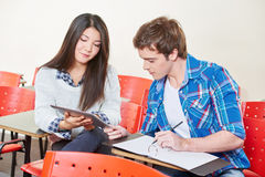 Two students with a tablet in high school Stock Photos