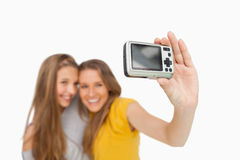 Two students taking a picture of themselves Royalty Free Stock Image