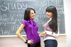 Two students talking Royalty Free Stock Photo