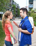 Two students talking on campus. Two students , male and female, talking at campus of the University about the exam Stock Photography