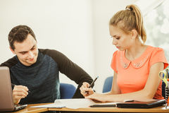 Two students talking in classroom Royalty Free Stock Images