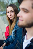 Two students talking in the street after class. Royalty Free Stock Image