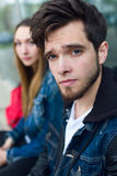 Two students talking in the street after class. Royalty Free Stock Photography