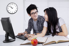 Two students talking and studying together Stock Images