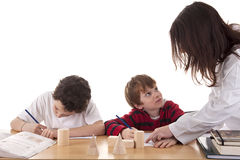 Two students with the teacher Royalty Free Stock Photography