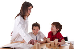 Two students with the teacher Stock Photo