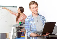 Two students with three-dimensional printer Royalty Free Stock Image