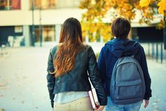 Two students walk royalty free stock photos