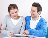 Two students working with a tablet Royalty Free Stock Images