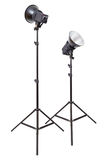 Two studio flash light monoblocks on tripods. Isolated on white background Stock Photo