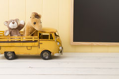 Two stuffed animal toys in a truck. School Royalty Free Stock Image