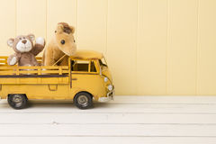 Two stuffed animal toys in a truck Royalty Free Stock Photo