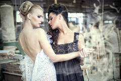 Two stunning ladies in a dancing pose Royalty Free Stock Photo