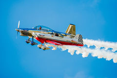 Two Stunt Planes Flying Side by Side. SAN ANTONIO, USA - October 31, 2015: Two Stunt Planes Flying Side by Side Royalty Free Stock Photo