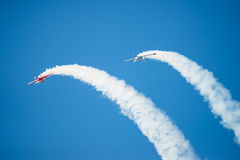 Two Stunt Planes Perform Flip Stock Photos