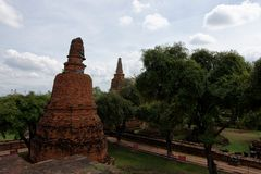 The two stupa. The pagoda and ancient castle or what we so roughly called temple which Buddha statue in front or inside of the structures in the area of Wat Stock Photos
